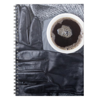 Caderno Espiral Vista superior de uma chávena de café branca e de