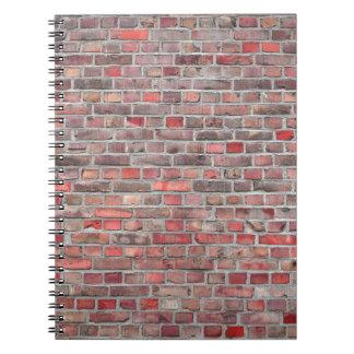 Caderno fundo da parede de tijolo - pedra vermelha do