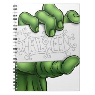 Caderno Mão do monstro do zombi que guardara o sinal feliz