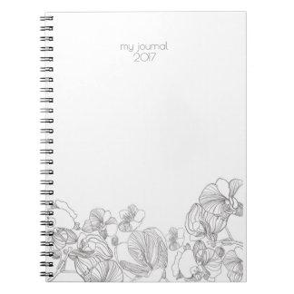 Caderno ou jornal floral simples