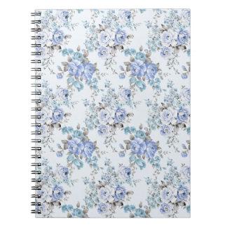 Caderno rosado azul do teste padrão de flor