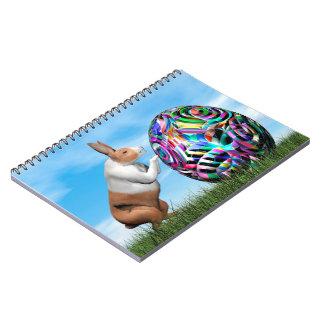 Cadernos Coelho que empurra o ovo da páscoa - 3D rendem