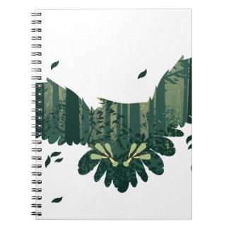 Cadernos Coruja e paisagem da floresta do abstrato