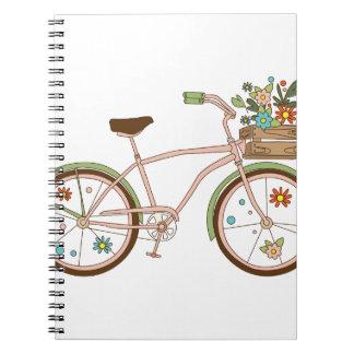 Cadernos Espiral Bicicleta retro com o karzinkoy para flores