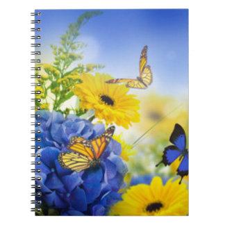 Cadernos Espiral Flores amarelas azuis com borboletas