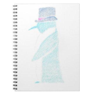 Cadernos Espiral Pinguim em um chapéu alto