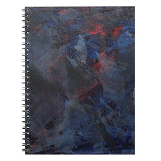 Cadernos Espiral Preto e branco no fundo azul e vermelho