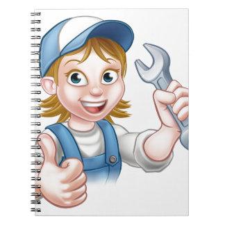 Cadernos Mecânico ou canalizador fêmea com chave inglesa