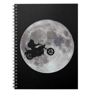Cadernos Pé grande, bicicleta grande e uma lua brilhante