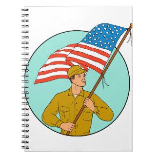 Cadernos Soldado americano que acena o desenho do círculo