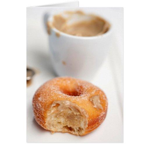 Café e uma rosquinha para o pequeno almoço cartao