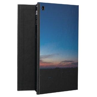 Caixa azul do céu do alvorecer para o ar do iPad