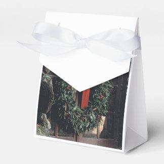 Caixa do favor com design da grinalda do Natal