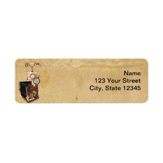 Câmera antiga do compasso do pergaminho e do etiqueta endereço de retorno