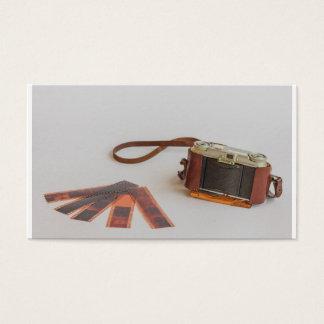 câmera velha com negativo   no cartão de visita
