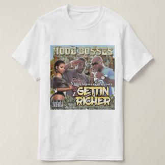 Camiseta A capa dirige - obtendo mais rico - o t-shirt