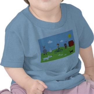Camiseta com o menino na bicicleta & em animais bo