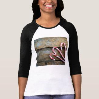 Camiseta Madeira rústica com os bastões de doces do Natal