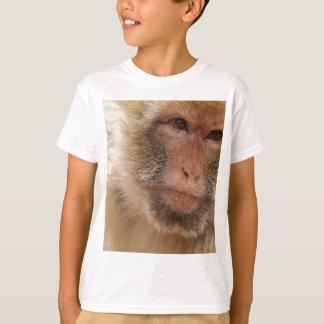 Camiseta O t-shirt do miúdo da cara do macaco