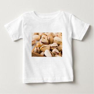 Camiseta Para Bebê Ideia macro do fim-acima de um grupo de pistachio