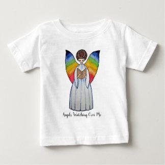 Camiseta Para Bebê O anjo da aguarela com arco-íris voa lendo um
