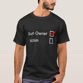Camiseta Proprietário ou vítima de arma