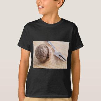 Camiseta Vista macro em nozes e em fim-acima da forquilha