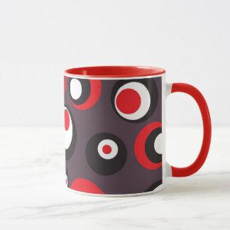 Caneca abstrata do preto, a vermelha e do branco