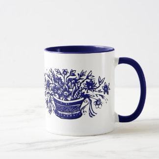 Caneca Cesta azul e branca da flor do vintage