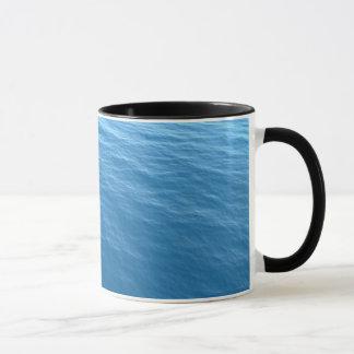 Caneca combinado da campainha da foto do mar