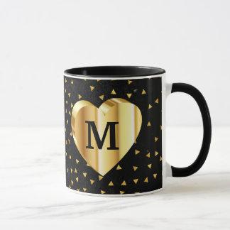 Caneca Coração do ouro do monograma no preto e no ouro