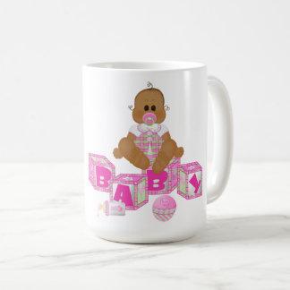 Caneca da campainha do presente do bebê