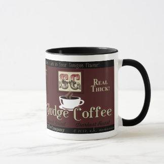 Caneca da marca do café da lama
