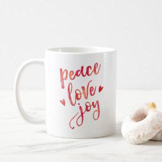 Caneca da tipografia do Natal da alegria do amor
