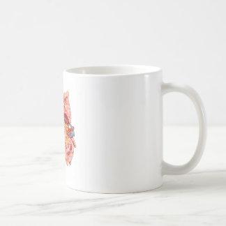 Caneca De Café A mão fêmea guardara o modelo do rim humano
