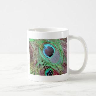 Caneca De Café A pena de fluxo do pavão dos olhos azuis