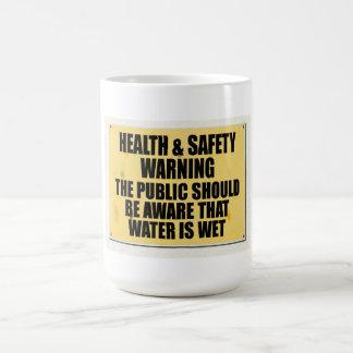 Caneca De Café A saúde e a segurança idas loucas, água estão