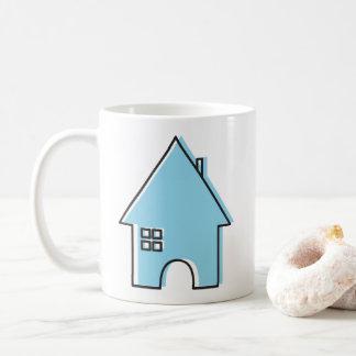 Caneca de café azul da casa