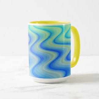 Caneca de café azul do desenhista da areia por