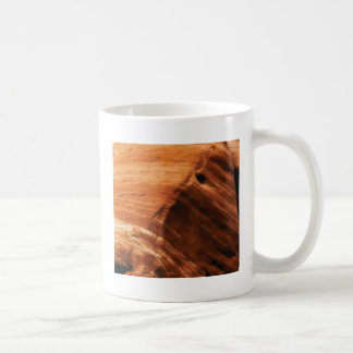 Caneca De Café borda mergulhada da rocha
