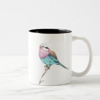 Caneca de café colorida do contraste do pássaro