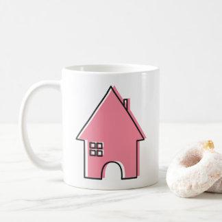 Caneca de café cor-de-rosa da casa