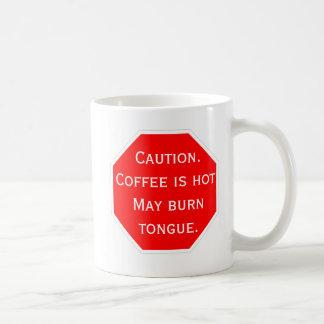 Caneca De Café Cuidado.  O café está quente