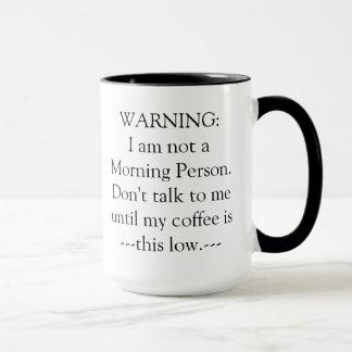 Caneca de café de advertência