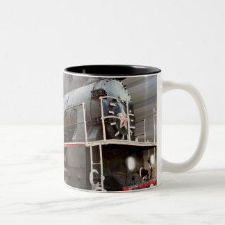 Caneca de café de pressa do trem