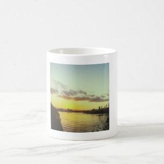 Caneca de café do por do sol