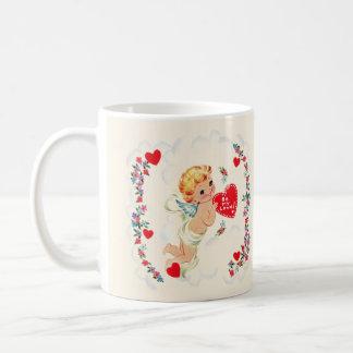 Caneca de café dos namorados do Cupido do vintage