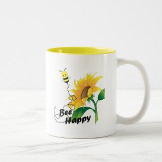 Caneca de café feliz da abelha