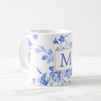Caneca De Café inicial azul da porcelana da flor branca