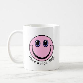 Caneca De Café O smiley face cor-de-rosa tem um dia agradável
